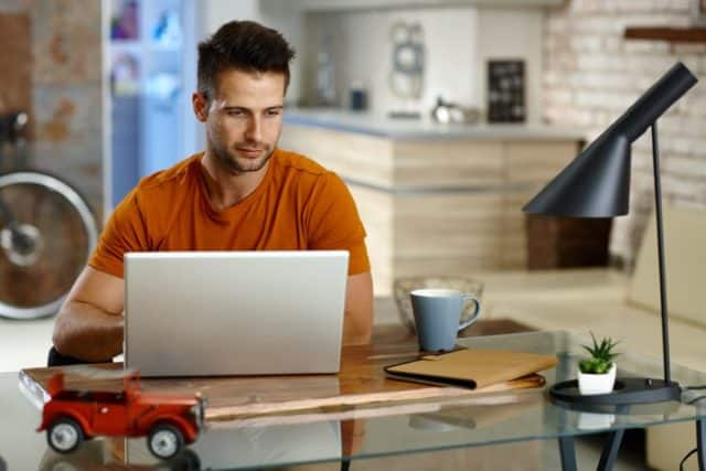 Young man working at home