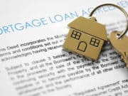 Pair of keys and a mortgage loan agreement