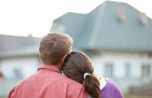 Couple gazing at a house