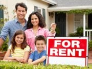 """Family with a """"For Rent"""" sign"""