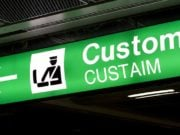 Green customs sign at airport