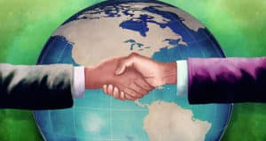 Businessmen shaking hands in front of a globe