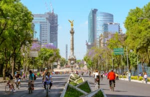 Bicyclists riding down Paseo de la Reforma in Mexico City