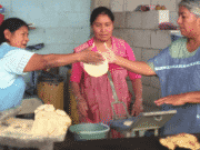 Mexican women making tortillas